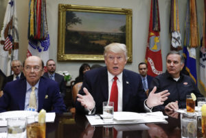 President Donald Trump, flanked by Commerce Secretary-designate Wilbur Ross, left, and Harley Davidson President and CEO Matt Levatich, talks to media before a lunch meeting with Harley Davidson executives and union representatives in the Roosevelt Room of the White House in Washington, Thursday, Feb. 2, 2017. (AP Photo/Carolyn Kaster)